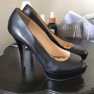 Black peep toe pumps